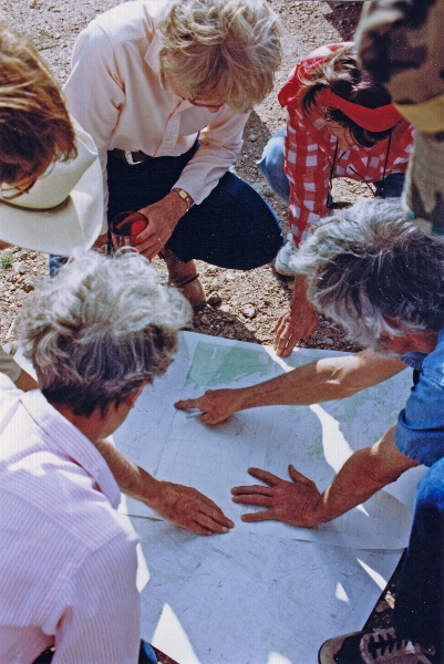 Chapter members examining a map